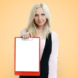 Successful businesswoman holding a clipboard with blank paper on Royalty Free Stock Photos