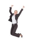 Successful businesswoman jumping against white background Stock Photography