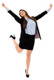 Successful businesswoman jumping for joy Stock Images