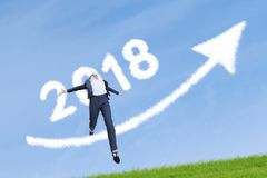 Successful businesswoman jumps with numbers 2018 Stock Photo