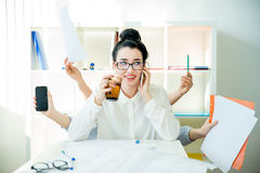 Successful businesswoman multitasking Stock Image