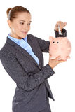 Successful businesswoman with a piggy bank Royalty Free Stock Photos