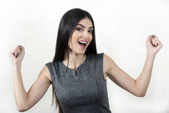 Successful businesswoman with raised arms. Smiling businesswoman with raised arms Stock Photography
