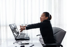 Successful businesswoman relaxing in her chair at the office Royalty Free Stock Images