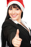 Successful businesswoman in santa hat Stock Images