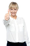 Successful businesswoman showing thumbs up Stock Photos