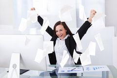 Successful businesswoman sitting at computer desk Royalty Free Stock Photography