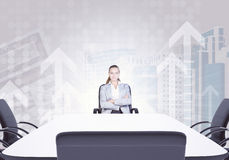 Successful businesswoman sitting at table Royalty Free Stock Photography