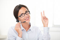 Successful businesswoman speaking on the earphone Stock Images