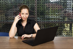 Successful businesswoman speaking on her mobil phone Royalty Free Stock Image