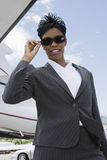 Successful Businesswoman Standing At Airfield Stock Photo