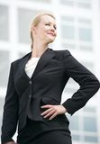 Successful businesswoman standing outside office building Stock Photos