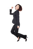 Successful businesswoman in suit jumping joyful Royalty Free Stock Photo
