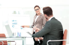 Successful businesswoman in suit at the office leading a group. Successful  Woman making a business presentation to a group Stock Photos