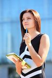 Successful businesswoman taking notes Royalty Free Stock Photo