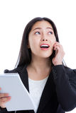 Successful businesswoman talking on the phone and holding note p Stock Image