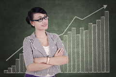 Successful businesswoman with upward graph Royalty Free Stock Photos