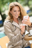 Successful businesswoman using smartphone Royalty Free Stock Photo