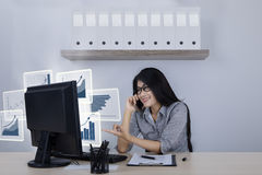 Successful businesswoman with virtual growth graphs Royalty Free Stock Photography