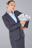 Successful businesswoman with a wad of money Royalty Free Stock Images