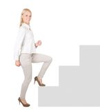 Successful businesswoman walking up a staircase Royalty Free Stock Image