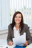 Successful businesswoman working at her desk Stock Photography