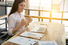 Successful businesswoman working in the office. happy female sta Stock Photography