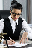 Successful businesswoman writing Stock Images