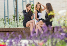 Successful businesswomen in the city on a bench.  stock image