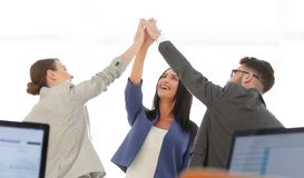 Successful businesswomen motivate each other with High Five. Happy business team giving high five in office royalty free stock photos