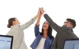 Successful businesswomen motivate each other with High Five. Happy business team giving high five in office stock image