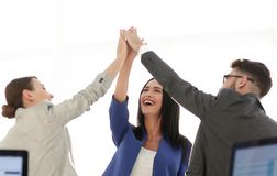 Successful businesswomen motivate each other with High Five. Happy business team giving high five in office royalty free stock image