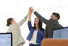 Successful businesswomen motivate each other with High Five. Happy business team giving high five in office stock photos