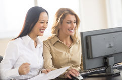 Successful Businesswomen Using Computer In Office Royalty Free Stock Photo