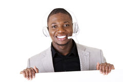 Successful call center worker with blank board Stock Images