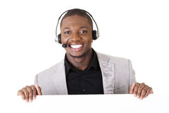 Successful call center worker with blank board Stock Image