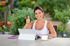 Successful casual woman with laptop outside Royalty Free Stock Images