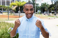Successful cheering african american man Stock Photography