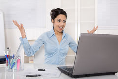 Successful cheering businesswoman looking happy at the screen of Royalty Free Stock Photos