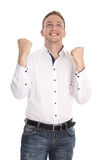 Successful cheering isolated young blond man making fist gesture Stock Photo