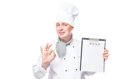 Successful chef with blank menu shows a gesture all ok Royalty Free Stock Photo