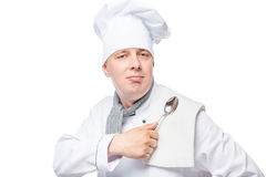 Successful chef with a towel and a spoon Royalty Free Stock Image
