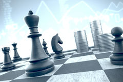 Successful chess tactics to achieve business target on a blue in Royalty Free Stock Photography