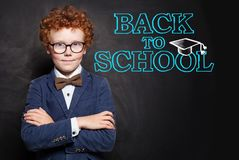 Successful child smart student boy on chalkboard background, back to school concept.  royalty free stock photo
