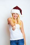 Successful Christmas woman. Blond happy smiling woman on christmas with thump up Stock Photos