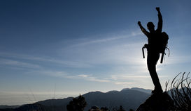 Successful climber silhouette. Mountaineer silhouette model.successfully reach the mountain summit stock photo