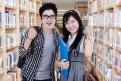 Successful college students in library Stock Images