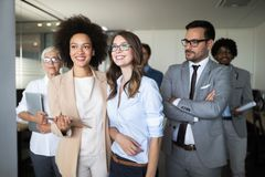 Successful company with happy workers in office stock photography