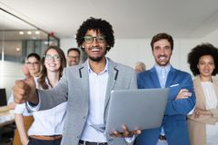 Successful company with happy workers in office. Successful company with happy workers in modern office stock photo