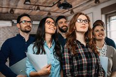Successful company with happy workers. Successful company with happy employees in modern office Royalty Free Stock Photo